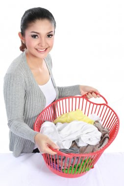 pretty asian woman with laundry