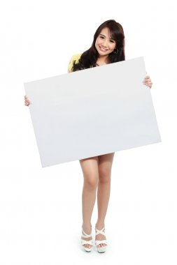 teenager girl holding banner