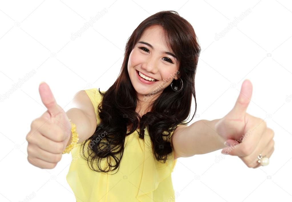 Beauty teenager girl showing thumbs up