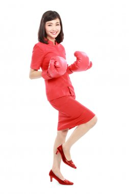 Portrait of woman excited with red boxing gloves