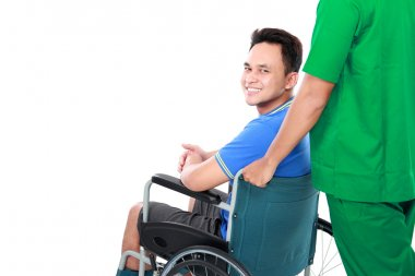 male with broken arm and foot using wheel chair