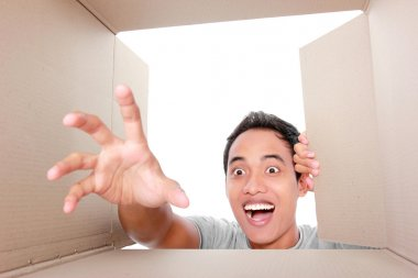 man trying to take something inside box
