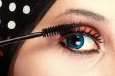 Fotografie Woman applying mascara