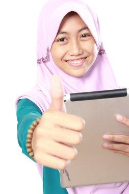 muslim girl using tablet computer
