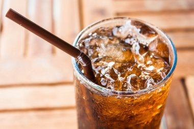 Cold glass with ice black soda drink