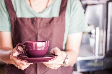 Shop owner serving freshly brewed coffee