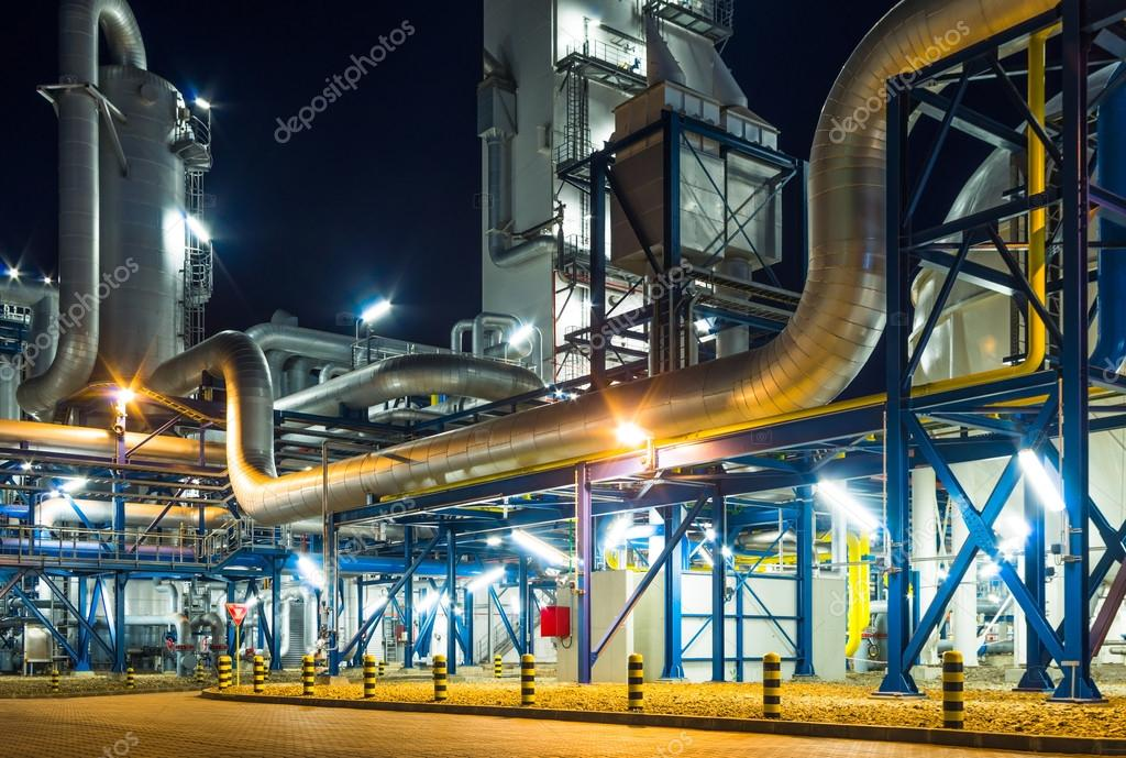 Pumps and piping system inside of industrial plant at night stock vector