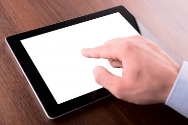 Hand on a touch screen of tablet pc