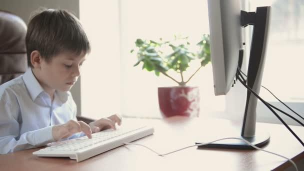 Child typing on keyboard.