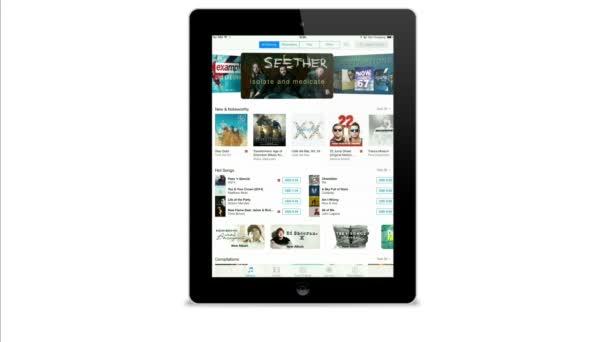 ITunes application on a black iPad display