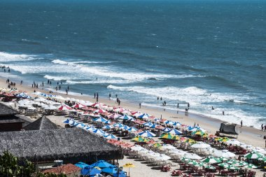 Beach umbrellas and tourists on the beach