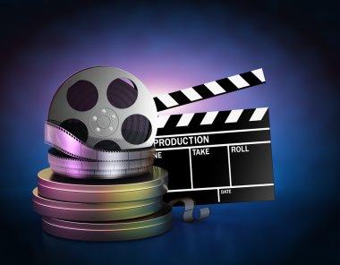 Movie film reels and cinema clapper