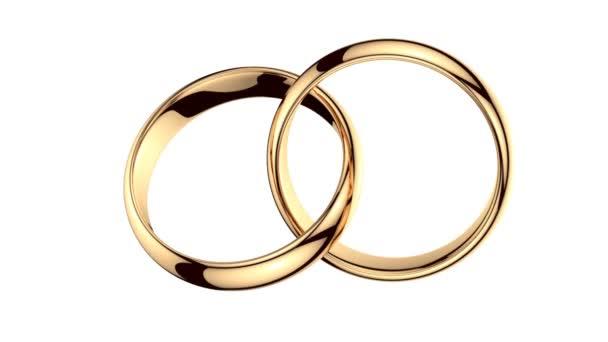 dva zlaté prsteny na bílém pozadí