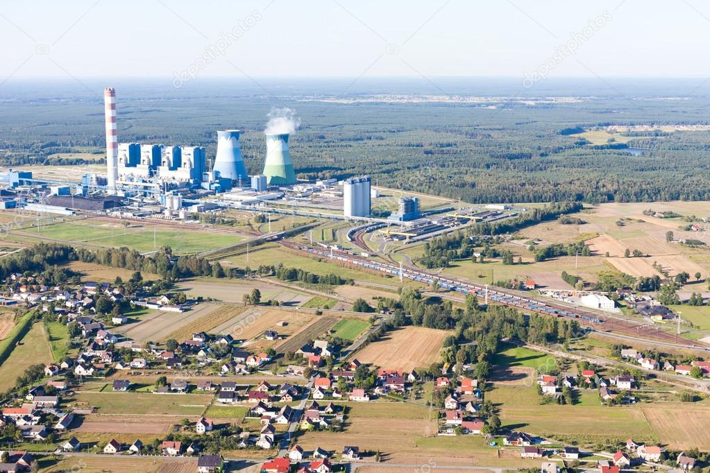 Aerial view of power plant and harvest fields