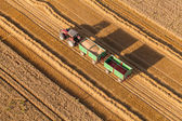 Aerial view of tractor on harvest fields