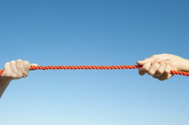 Isolated Hands pulling rope