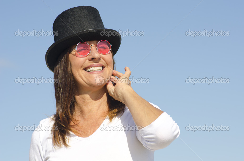 Happy hat wearing woman sky background — Stock Photo © roboriginal ... a6ab4edc361