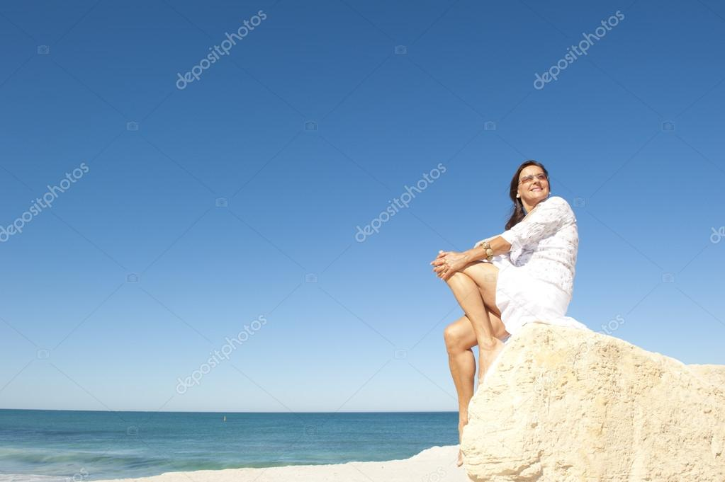 Middle aged woman ocean background
