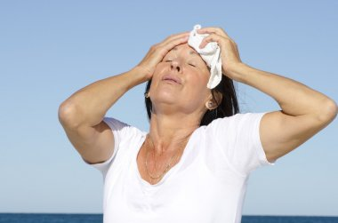 Mature woman exhausted stress sweating