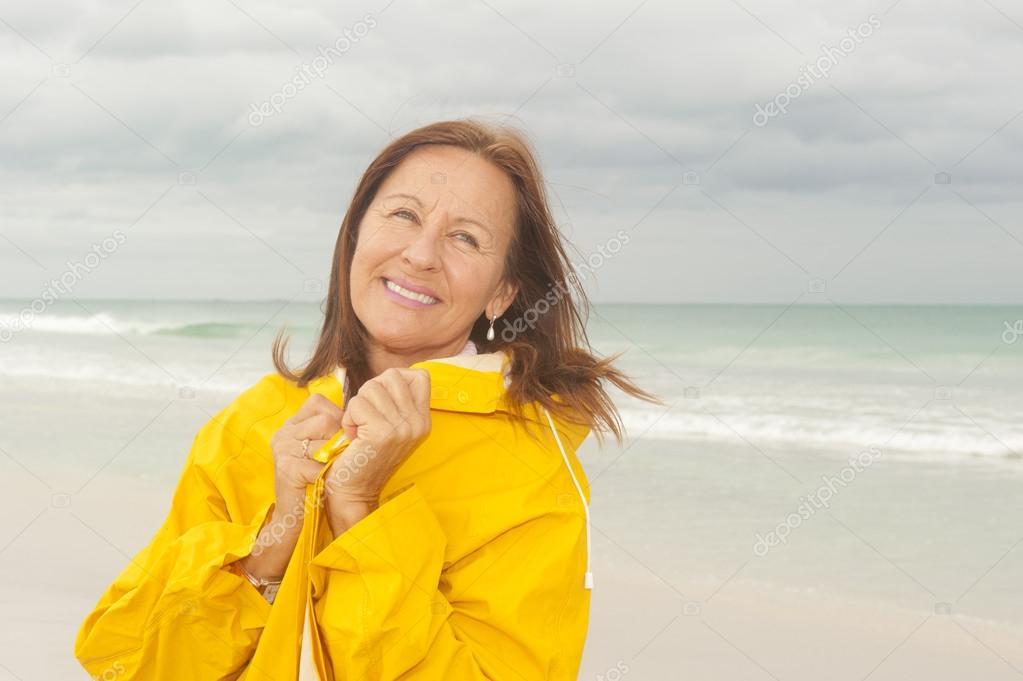 Happy Woman raincoat autumn season at beach