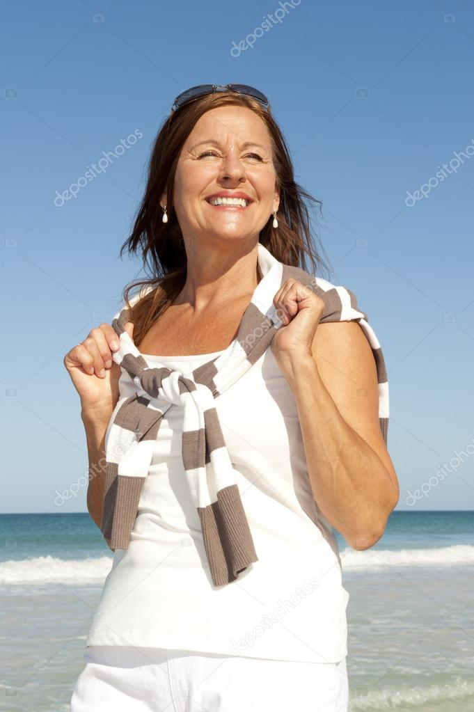 Beautiful mature woman beach holiday isolated