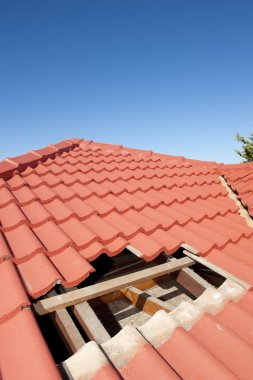 Damaged red tile roof construction