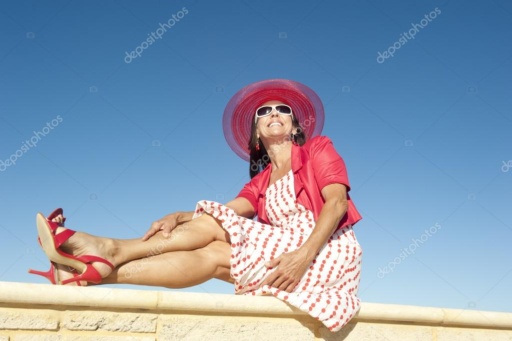 Sexy happy mature woman isolated sky background