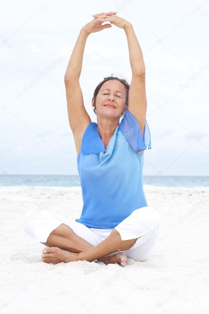 Portrait peaceful mature woman beach