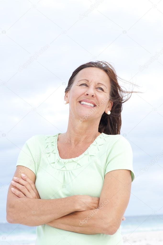 Confident happy mature woman beach