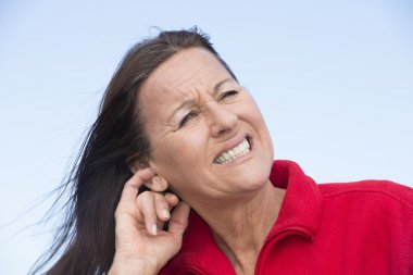Worried stressed woman scratching ear