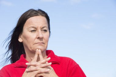 Worried middle aged woman wrinkled forehead
