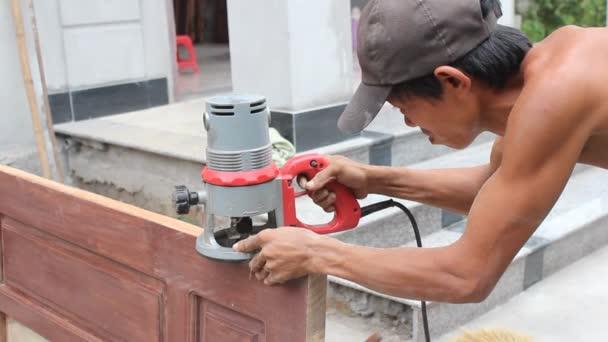 Worker used wood planers making wood door u2014 Stock Video & Worker used wood planers making wood door u2014 Stock Video ...