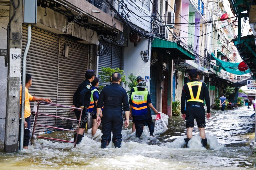 Unidentified people try to protect Bangkok from flood during the worst flooding in Bangkok, Thailand