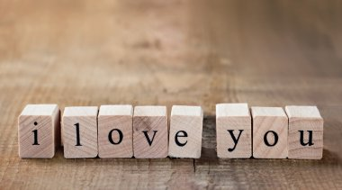 Message I love you spelled in wooden blocks