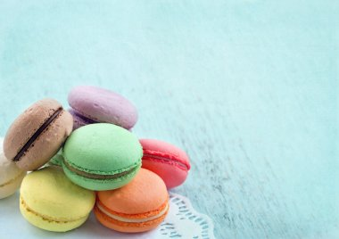 Macaroons on blue textured shabby chic background