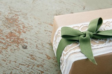 Decorative gift box wrapped in brown eco paper