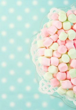 Pink marshmallows on polkadot blue blurred background with vintage nostalgic editing stock vector