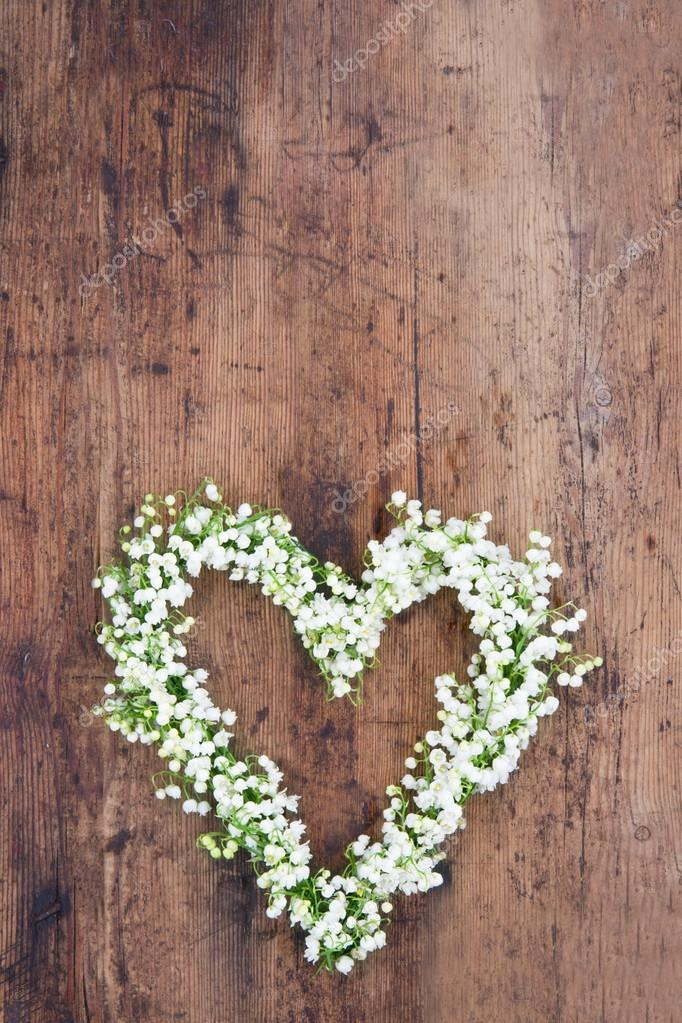 Heart Shaped Flower Wreath On Rustic Background Stock Photo