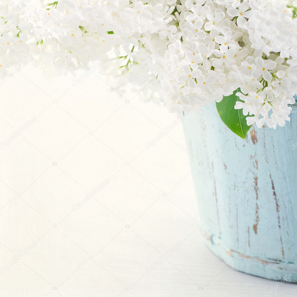 Lilacs in a wooden blue vase