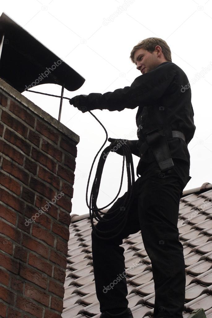 chimney sweep at work