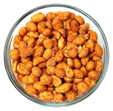 Honey Roasted Peanuts in a Glass Bowl Over White.
