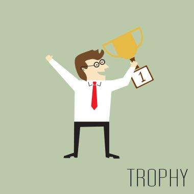 Businessman holding a trophy
