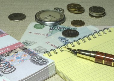 Money, pen and watches