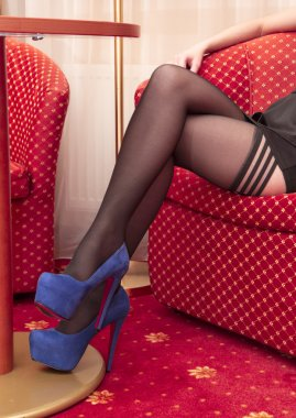 Beautiful legs in black stockings and in high heels