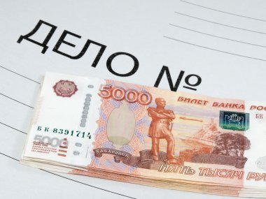 Banknotes lying on the folder with the criminal case