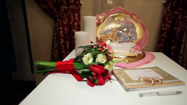 Large greeting card and wedding flowers on the table