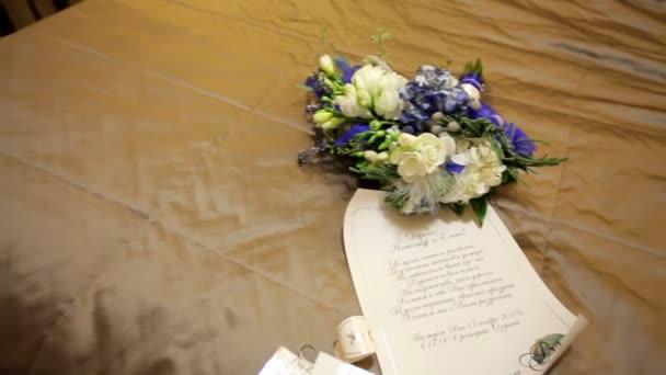 Wedding invitation and beautiful bridal bouquet
