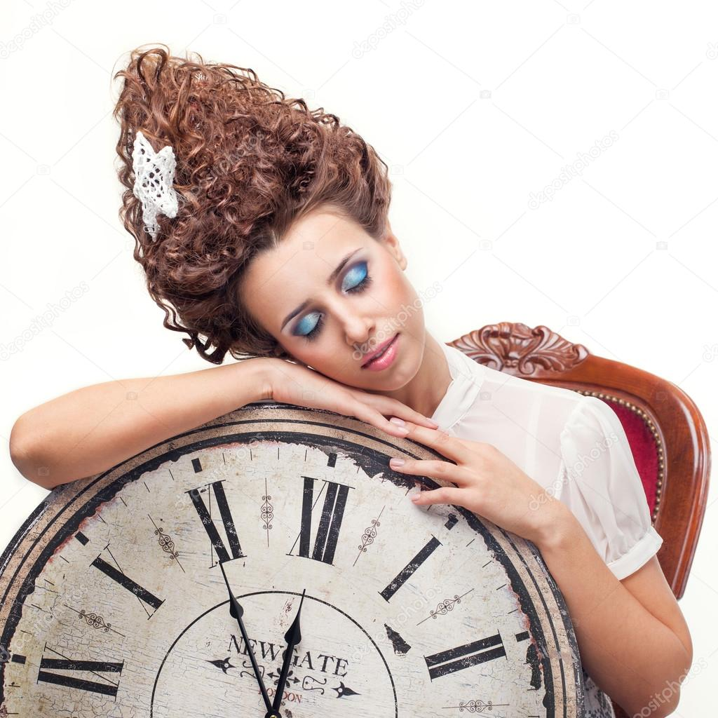 Portrait Of A Beautiful Girl With A Big English Clock Stock Photo