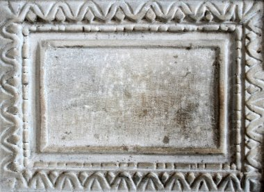 Old marble slab with carved frame