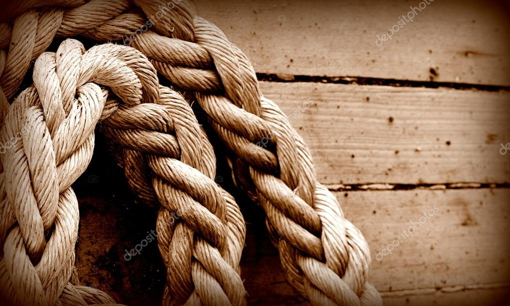 Old texture of wooden boards with ship rope